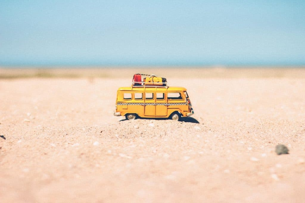 Toy Bus On A Beach For Digital Nomads