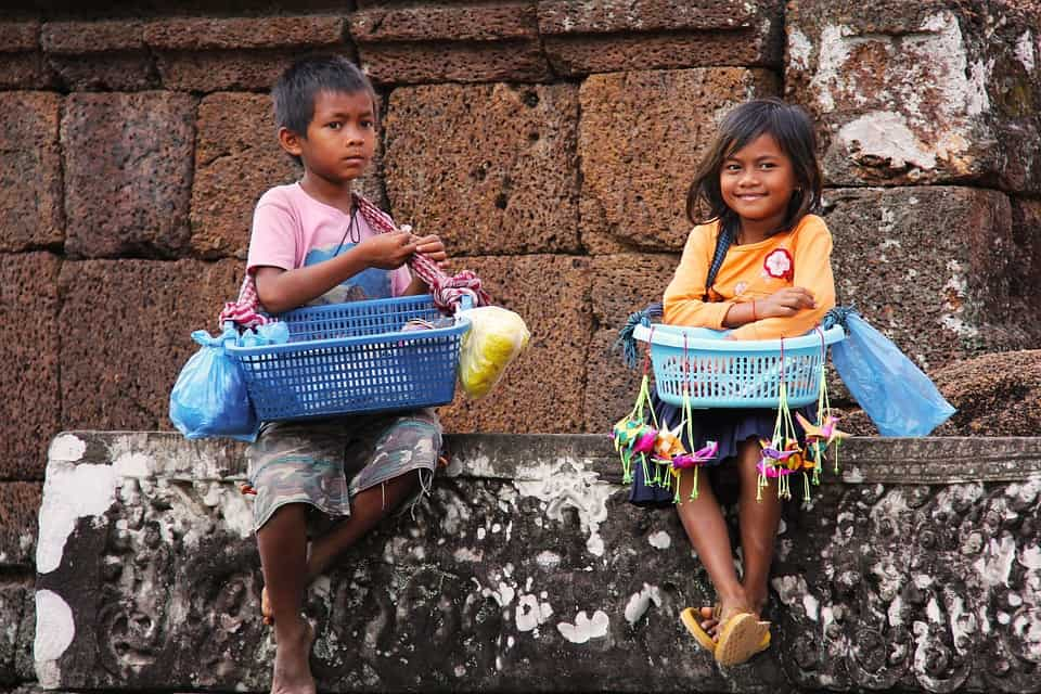 Kids sell souvenirs at Angkor. They speak English AND Khmer.