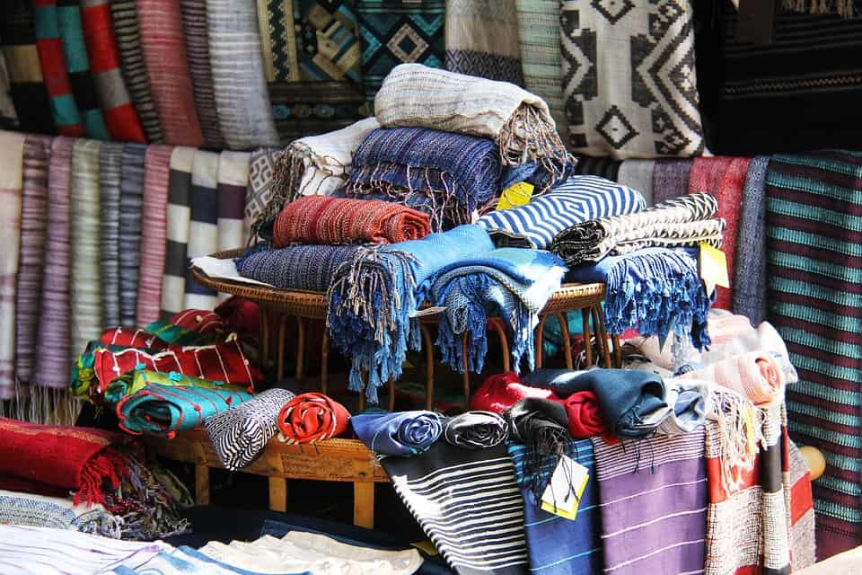 Clothes at a market stall in Asia.