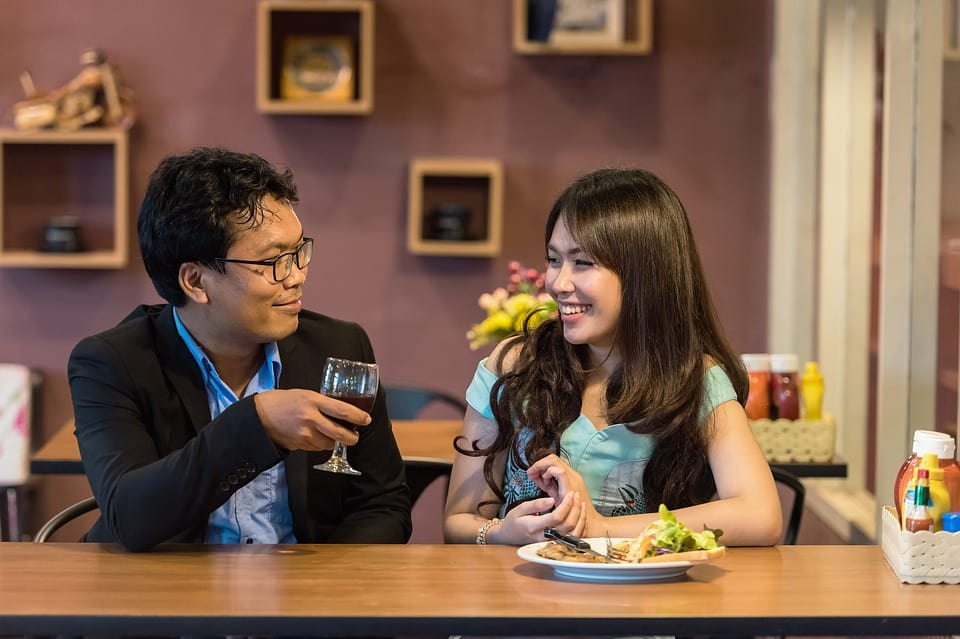 Here we see a Thai couple chatting in a restaurant.