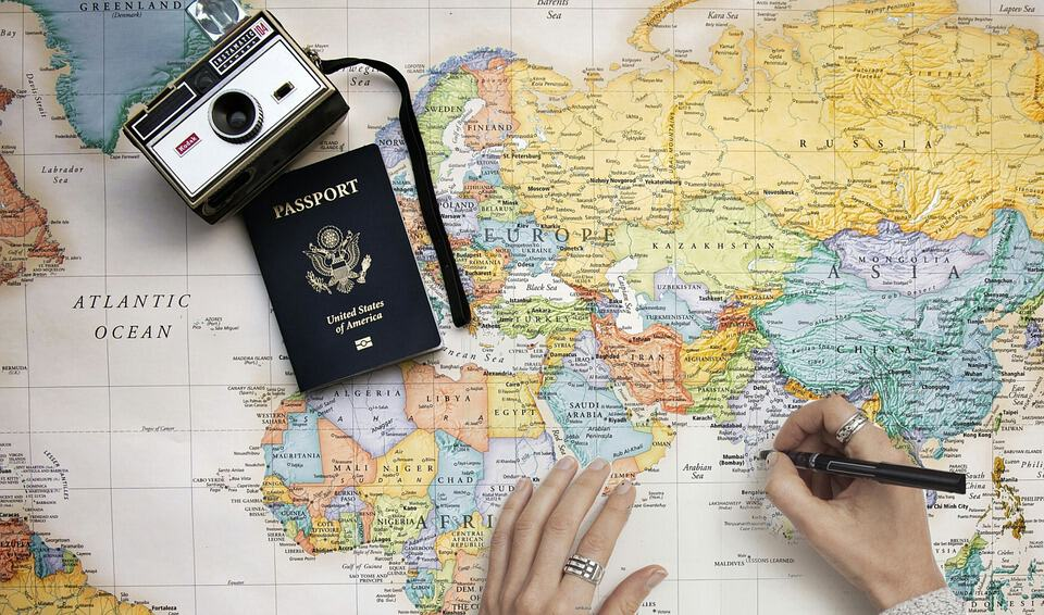 A passport, a map and a camera. Digital nomad heaven!