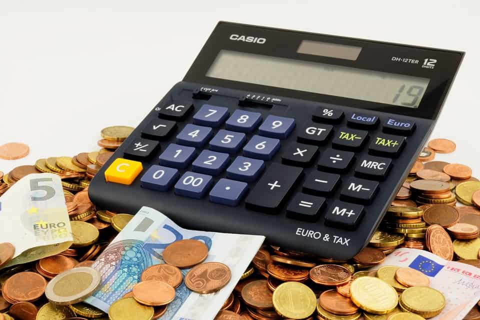 A calculator and some pennies, the results of poor finances.