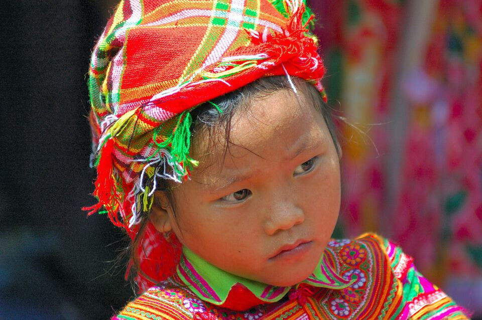 A little girl in traditional dress.
