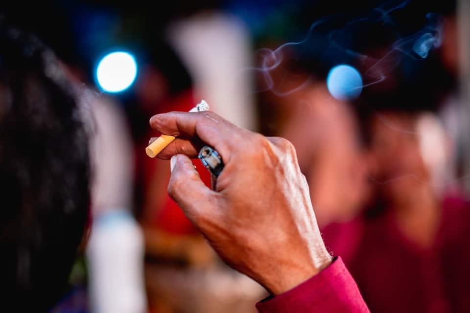A hand holding a smoke because smoking like the local healthcare, kills.